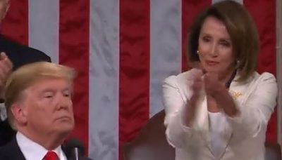 Nancy Pelosi clapping sarcastically at Donald Trump during State of the Union